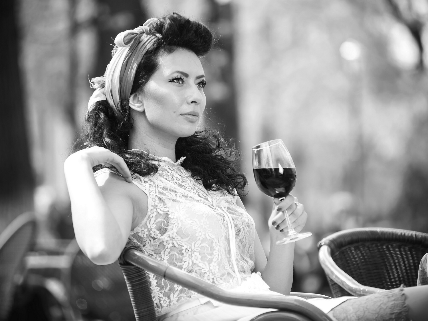 Beautiful young girl with glass of red wine pibarnon